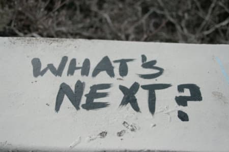 "Painted sign that reads ""What's Next?"""