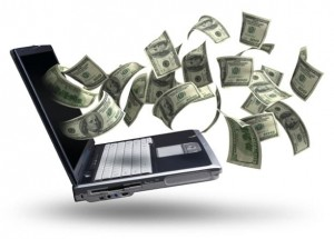 Money flying out of the screen of a laptop